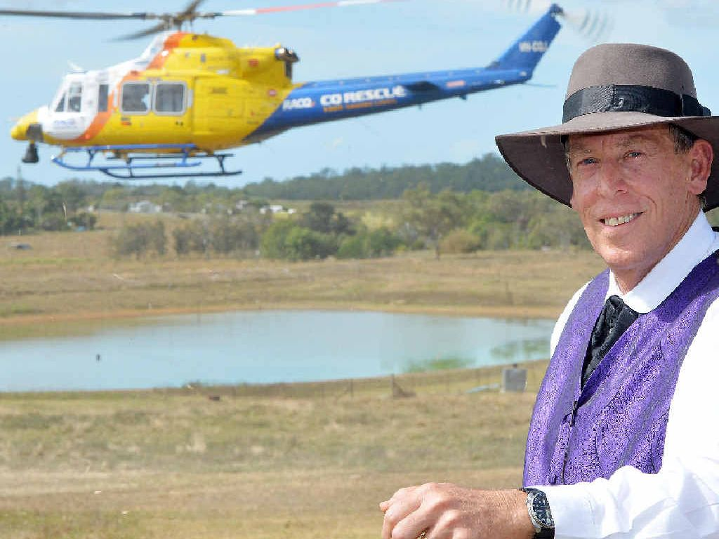 VITAL SERVICE: Mackay Regional Council museum co-ordinator Brian Osborn and the RACQ CQRescue Helicopter as it makes a low pass at the Greenmount Fair.