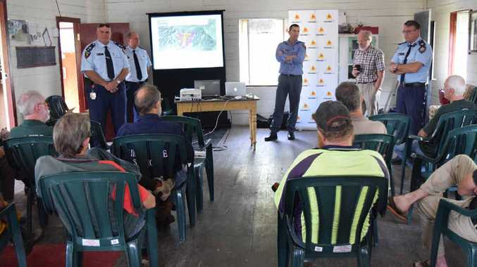 BE PREPARED: Byfield residents listen in on the information, about fuel loading, from rural fire authorities.