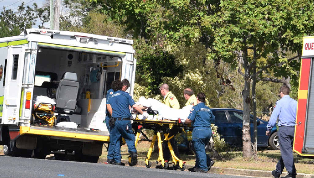 PATIENT STABLE: Paramedics and fire crews wheel a Wandal man to an ambulance after he called triple 0.