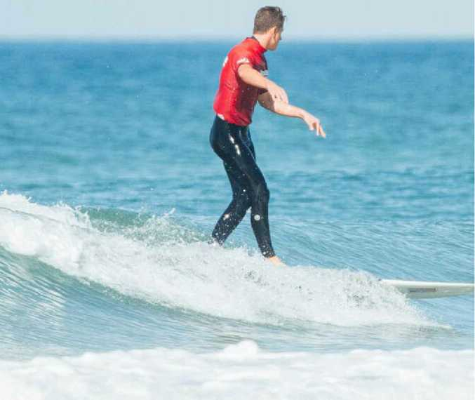 OFF FOR A WALK: Nic Jones in action yesterday at the Queensland Longborad Titles at Peregian Beach.