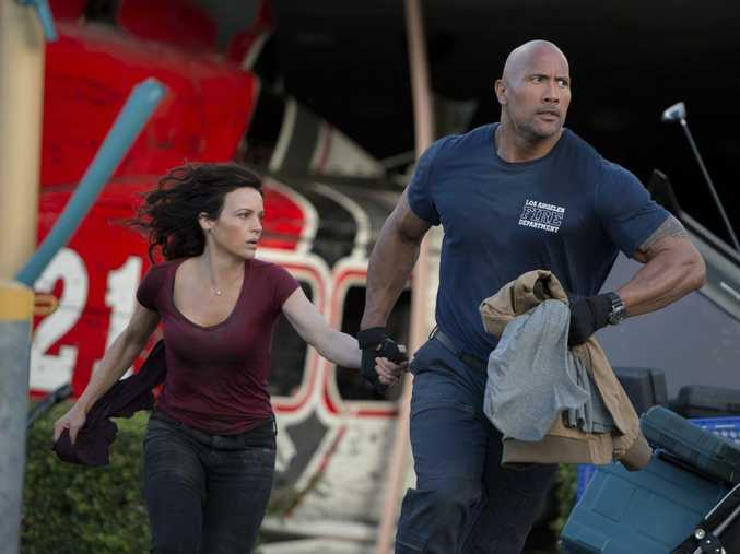 ON THE MOVE: Carla Gugino and Dwayne 'The Rock' Johnson in a scene from the movie San Andreas.