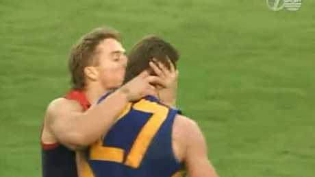 Allen Jakovich, of Melbourne, kisses brother Glenn Jakovich, of the West Coast, during a game in 1993. Photo: Channel Seven
