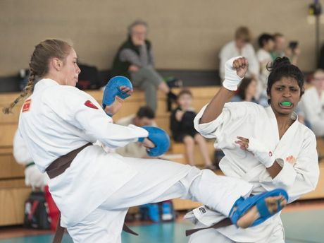 IN ACTION: Alison Dennis (left) takes on Samyuktaa Naidu in their points kumite bout at the Darling Downs Karate Championships.