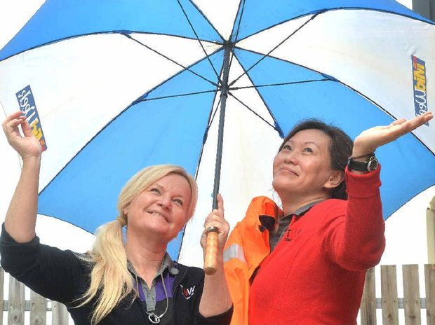 Germaine Lathouras and Fe Orcullo not sure what the weather is doing Photo Tony Martin / Daily Mercury