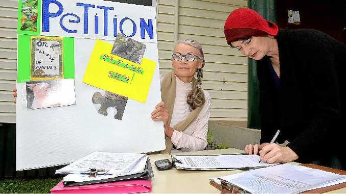 PROTEST: Linda Evans signs Christine Bennett's petition.
