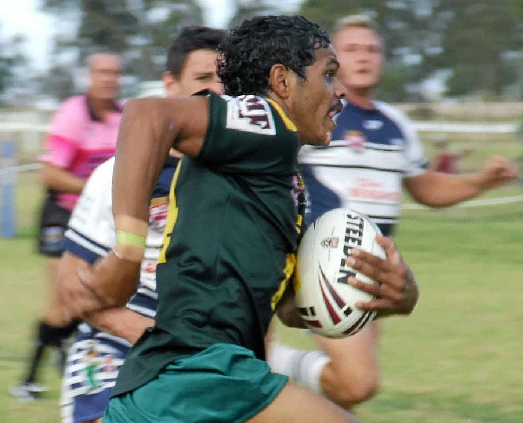 SPEEDSTER: Wattles centre Michael Purcell sprints away to score one of his four tries against Brothers.