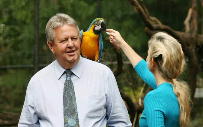 Former Rocky Mayor Brad Carter checks out one of the two macaws when they were first introduced at the zoo in 2012.  Sadly both birds have now died.