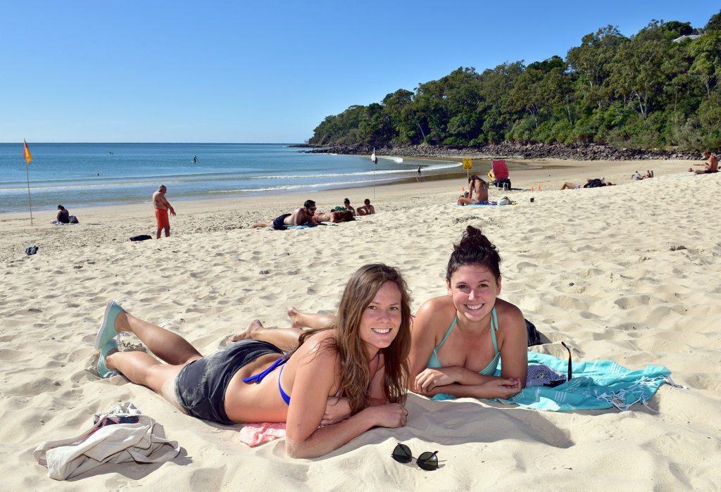 Main Beach Noosa.Elly Blair (left) from Melborne and Maggie Teper from Chicago enjoy Main Beach Noosa. Photo Geoff Potter / Noosa News