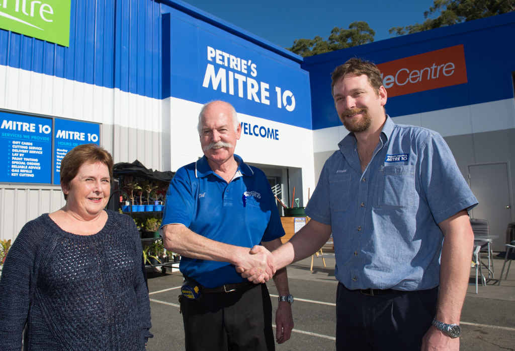 HANDOVER: Ted Bailey and wife Judy with new store manager Nathan Valentic. Trevor Veale