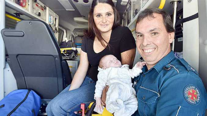 SPECIAL MOMENT: Paramedic Kendall Cox with baby Lexie and her mum Melissa Wilkins at the Howard ambulance station.