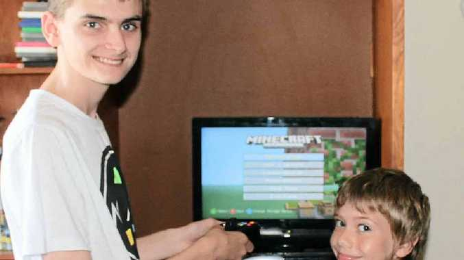 GOOD GAME: Noah and Terry, obsessed with Minecraft.