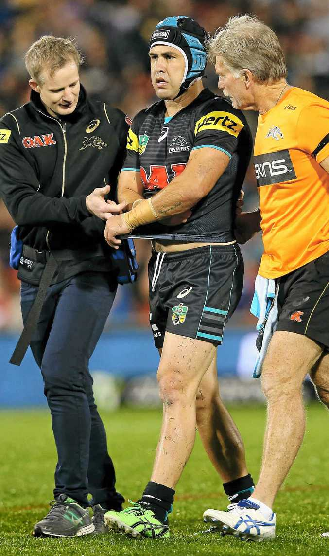 LATE-TACKLE VICTIM: Jamie Soward, of the Panthers, leaves the field with a shoulder injury last Friday night.