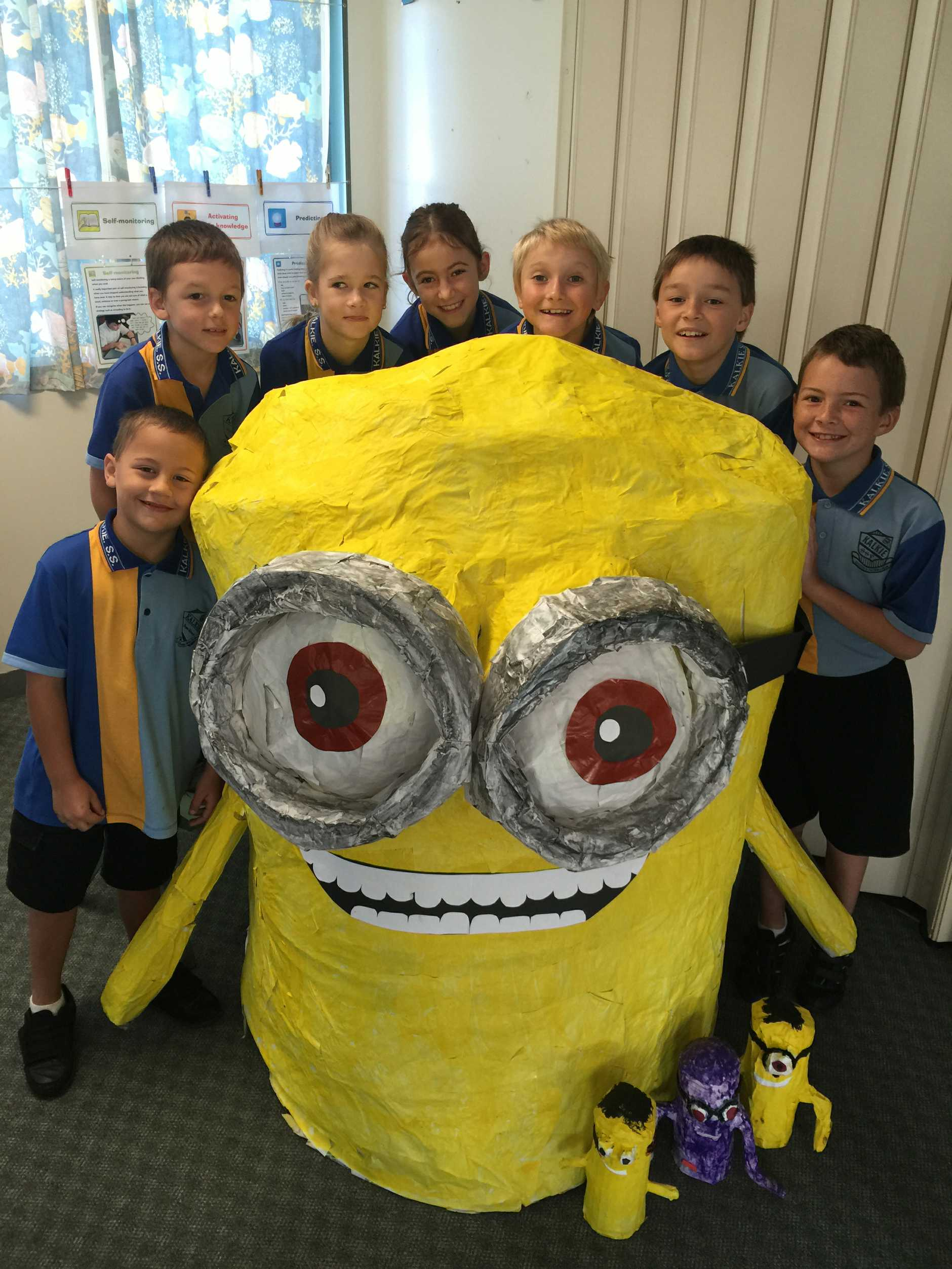 Pictured left to right Kalkie State School students Lance Wano, Josh Clark, Hallee Harris, Summer Towers, Trent Hitchenor, Jake Skerke, and Jordan Landman, with Minion Kal.
