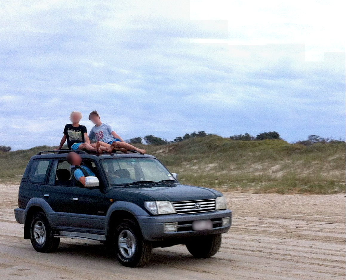 CAUGHT IN THE ACT: This vehicle was travelling at 30-40km on Airforce Beach at Evans Head with children on the roof.