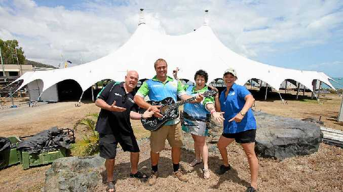 GATHERING MOMENTUM: Gavin 'Butto' Butlin (centre left), pictured with 2014 Airlie Beach Festival of Music committee members Kieran Mcarthy, Annie Freeman and Samantha Hayward, in front of the Whitsunday Sailing Club's main marquee.