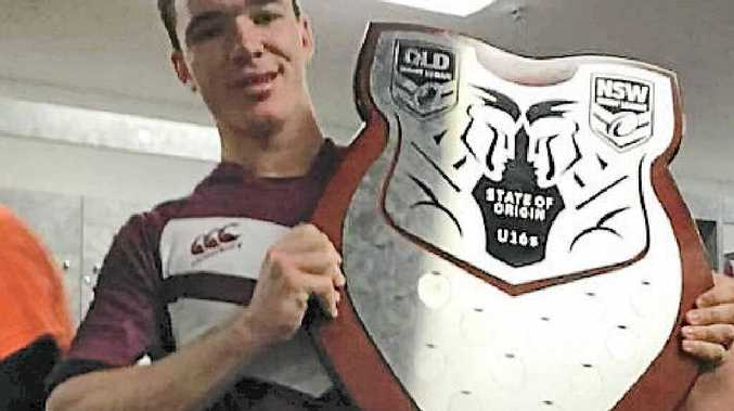 QUEENSLANDER: Proserpine's Nathan Barrett holds up the Under-16 State of Origin shield after scoring the game-winning try on Wednesday night at ANZ Stadium.