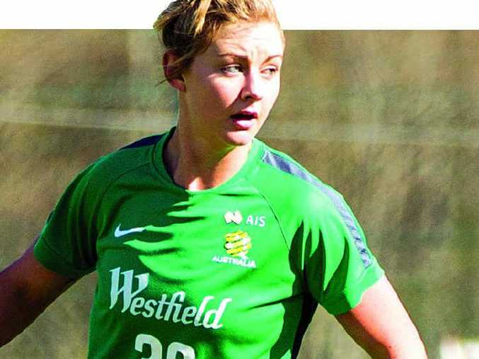 CONFIDENCE OF YOUTH: Larissa Crummer on the training paddock for the Matildas, ahead of their World Cup opener against the United States next week.