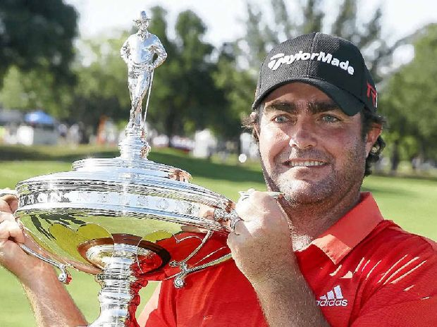 Steven Bowditch with trophy after winning the Byron Nelson golf tournament.