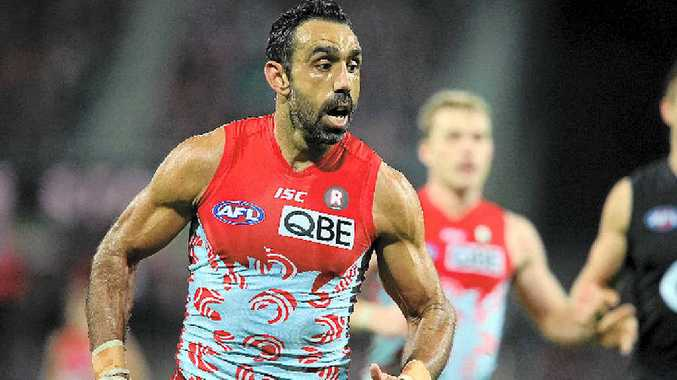 The NSW Parliament has congratulated Sydney Swans star Adam Goodes and condemned Eddie McGuire, inset.
