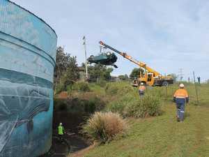 'Flying' car retrieved after crashing into reservoir walkway