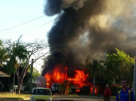 Amy Johnson took this photo of the house on fire in Kawana this afternoon on the corner of Roderkirchen and Boswoods Streets