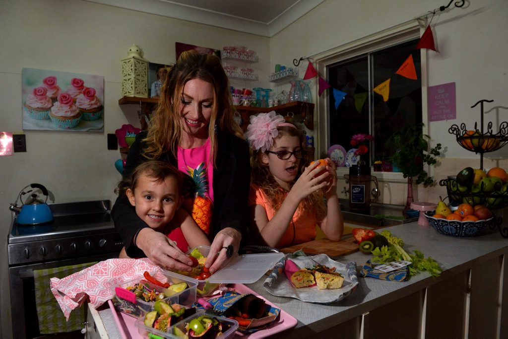Image for sale: Bek Mugridge with her children Lily, 9 and Violet Teubler, 4 are content if their lunch boxes are checked at school. Photo: John McCutcheon / Sunshine Coast Daily