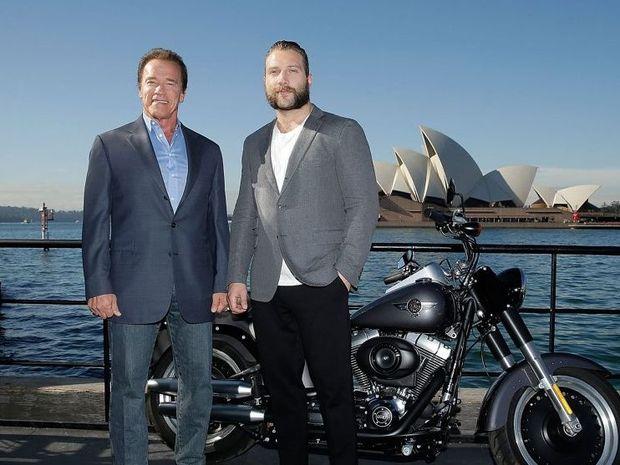Arnold Schwarzenegger and Jai Courtney pose during a Terminator Genisys photo call in Sydney, Australia.
