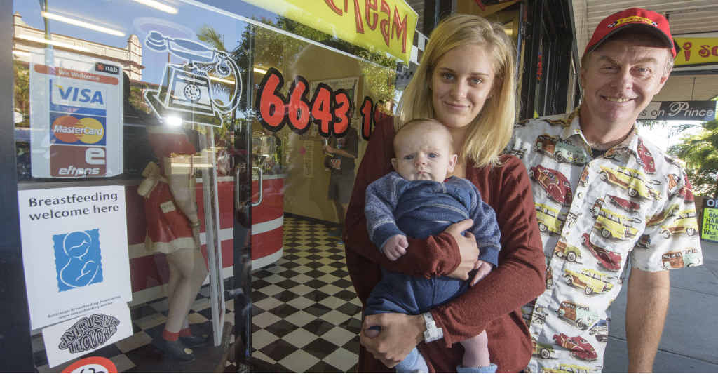 BREAST IS BEST: Beth Tanner with baby Finn with I Scream owner Jeff Smith – showing off the breastfeeding welcome sign on the shop. Photo: Adam Hourigan