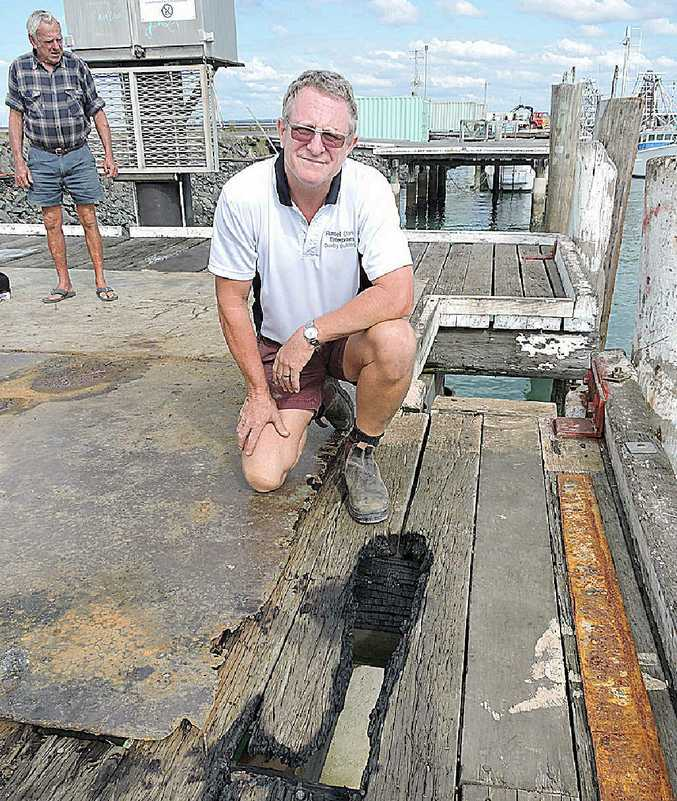 DIRTY WORK: Russell Clark inspects the damage.