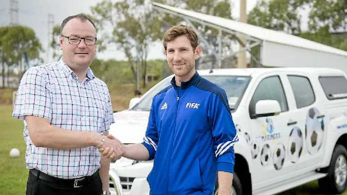 SOCCER SUPPORT: Alex Ward from Reef City Motors hands over the keys to CQ Mariners' Tom McDonald to help grow the game of football.