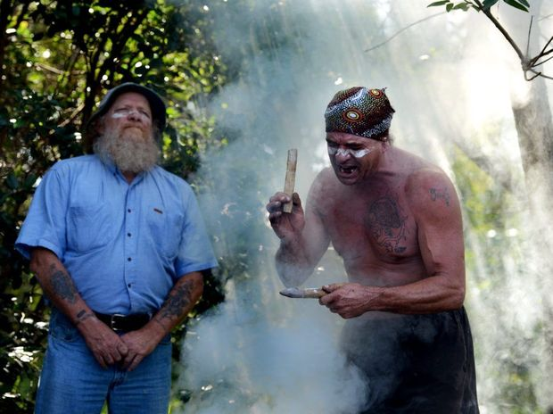 Michael Ryan, left, and Burrell Jakamarra at a smoking ceremony in North Lismore to mark opposition to the North Lismore plateau development. Photo Cathy Adams / The Northern Star