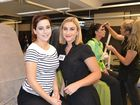 TAFE Queensland South West Diploma of Beauty Therapy students Claire Hamilton (left) and Taylah Burke take a break during the WorldSkills Australia Southern Queensland regional Beauty Care competition.