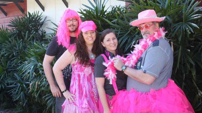 PRETTY IN PINK: Allenstown Hotel staff Graeme Moran, Cassie Smith, assistant manager Alarna Kingsley and venue manager Stephen Millar are ready to wash cars for cancer.