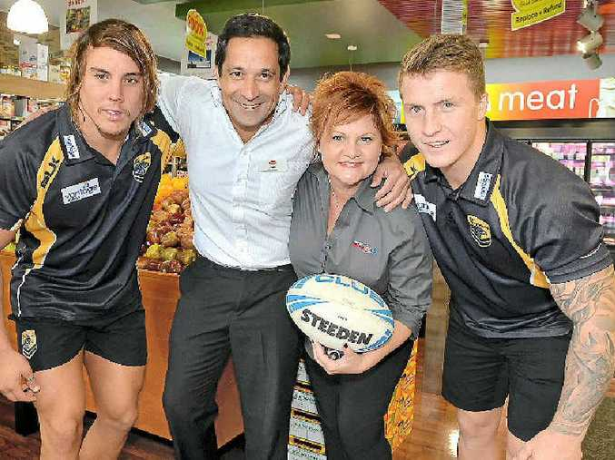 TIMELY HELP: Falcons Tom Murphy (left) and Rueben Bailie (right) pack down with Saul Fernandez and Roz White from IGA, sponsors of the Falcons.