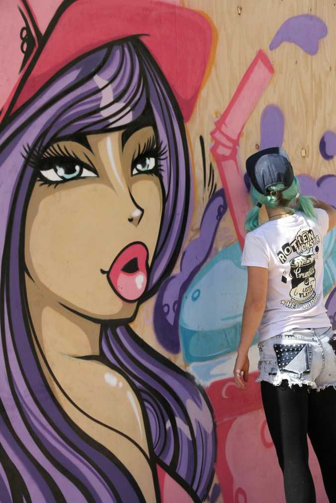 Maroochydore's Old Courthouse transformed into the first ever Sunshine Coast Street Art Project on Saturday, with creative markets, food vans and music and over 15 artists painting live murals around the venue. Cherie Lynch aka Buttons shows her colours as an artist. Photo: Pete Evans/ Sunshine Coast Daily