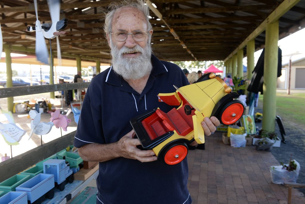 WOODEN TOYS: Tony Cornelissen with one of his handcrafted items at the PCYC Markets. Photo: Mike Knott / NewsMail