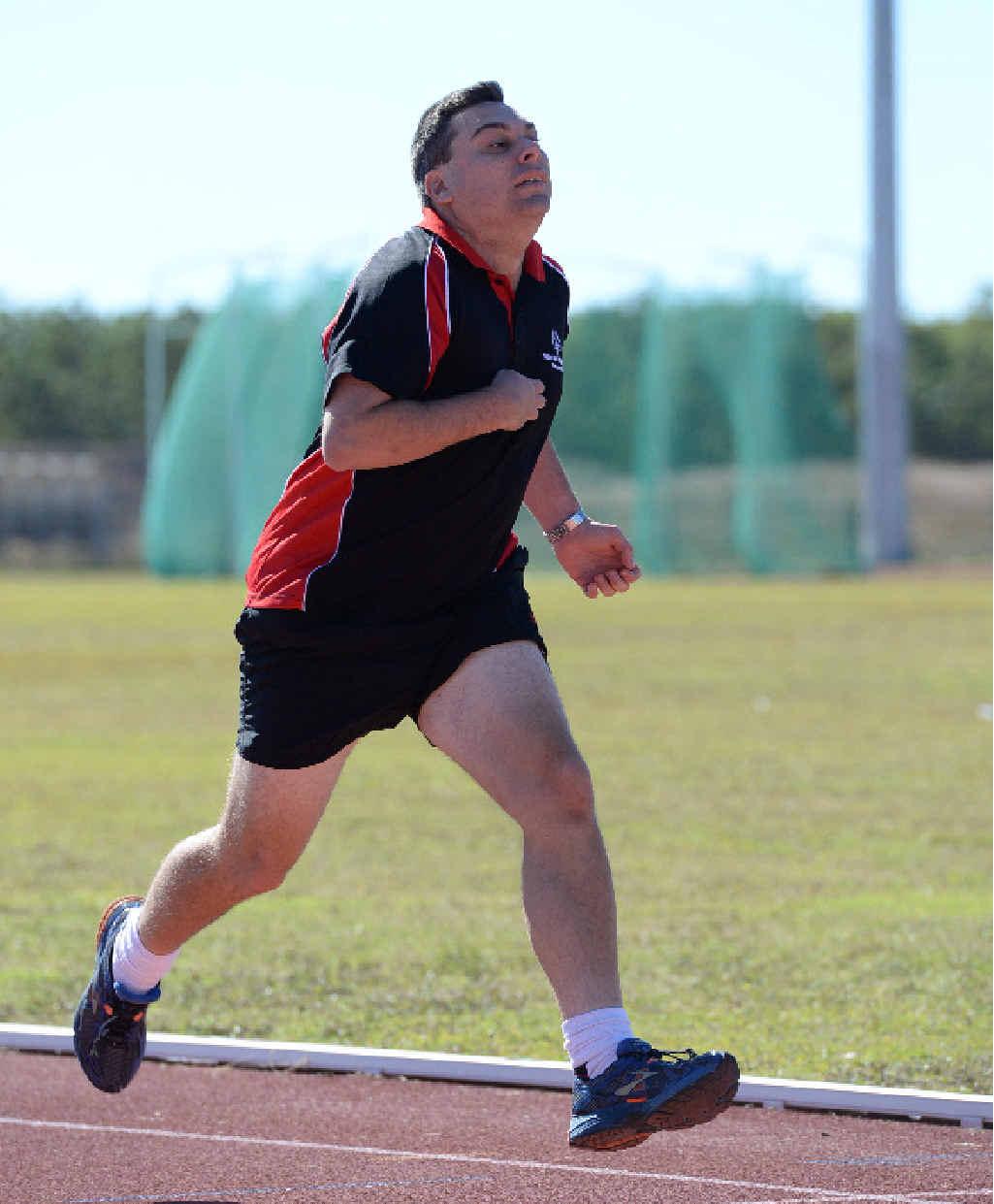 Jason Dixon sprints in the men's 200m.