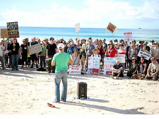 SPEAK UP: Councillor Duncan Dey addresses residents who turned out yesterday to protest a rock wall proposed to be built at Belongil.