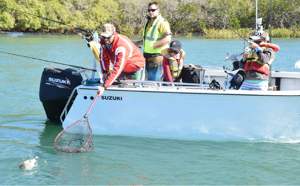 FISH FIGHT: Craig Allan helps his son Lachlan reel in his first bream of the competition.