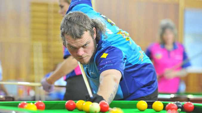 LOOKING ROUGH, PLAYING SMOOTH: Jamie Myles playing for Gladstone at the Central Queensland Zone 8-Ball Championships held at Boyne Island Community Centre.