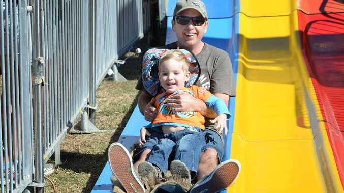 FATHER SON DAY: Craig Thwaite with son Hayden enjoying the big slide in Sideshow Alley.