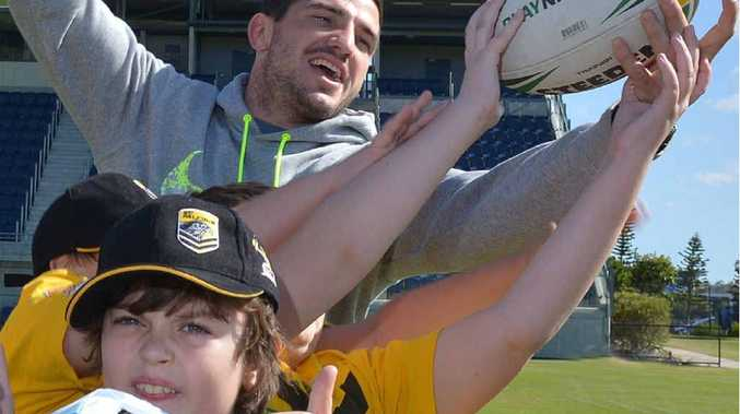 STAR ATTRACTION: Broncos and State of Origin representative Matt Gillett joins in a game with young rugby league players with disabilities at Sunshine Coast Stadium.