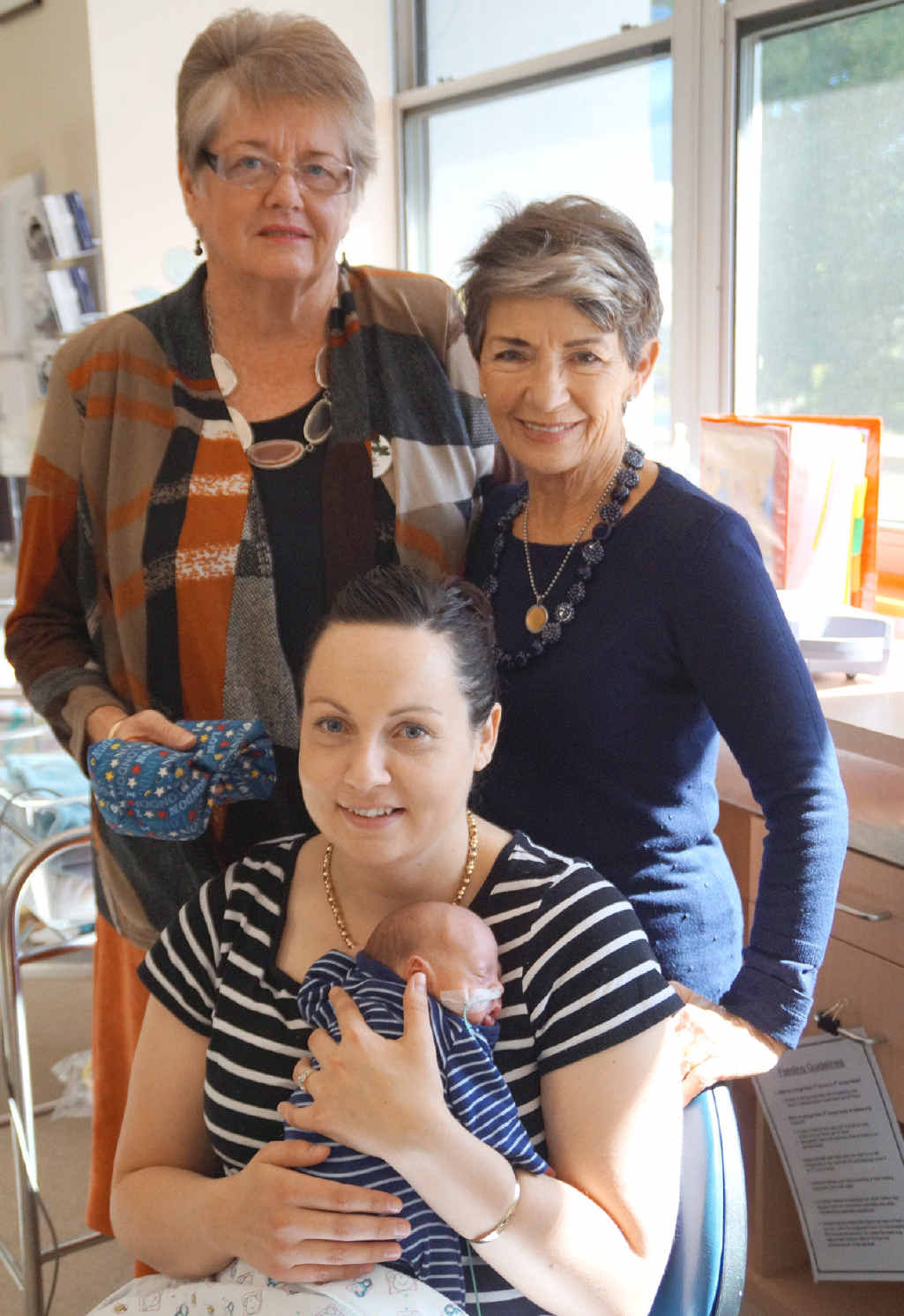 PREMMIE PILLOWS: The ladies of Toowoomba's Inner Wheel club have been busy sewing pillows for premmie babies in the Toowoomba Hospital Special Care Nursery. Mum Emma O'Brien (front) with her son Levi Garner who was born prematurely.