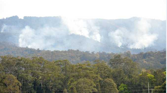 Smoke rises from a previous hazard reduction burn in the hills behind Upper Orara.