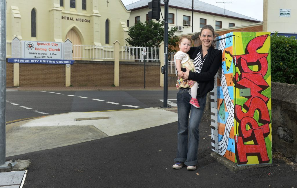 Kerry Laurent, with daughter Jayda Laurent-Roskam, is one of 40 local artists to have their art feature on traffic signal boxes around Ipswich.