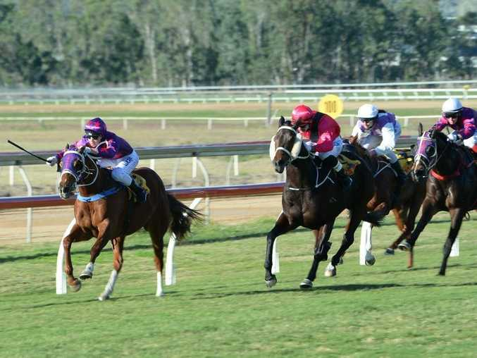 James Orman on Samara Girl winning the CQ Crane Hire Handicap (Race 4) at Callaghan Park on Saturday 6 Jun 2015. Photo: Chris Ison / The Morning Bulletin