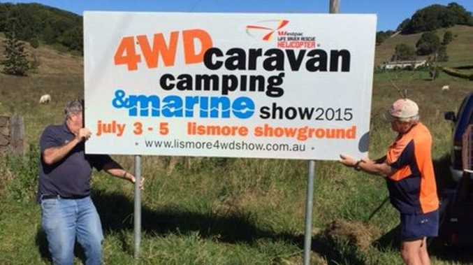 Staff members Ken Jolley and Tony Powell erecting signs in readiness for what is shaping up to be one of the biggest the Lismore 4WD, Caravan, Camping and Marine Shows yet. Photo Contributed