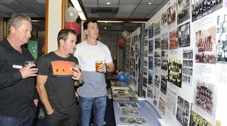 Scott Phelps, Scott Rae and Troy Jennings check out the memorabilia on display.