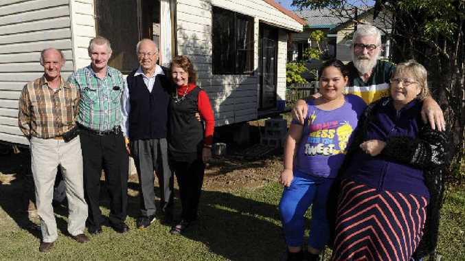 THANKYOU: (From left) Robin Gipp, Willem Van Der Heul and Paul and Carol Ordish and the family who have received the demountable Noel and Gloria Holmes and their granddaughter Kiara Perrett at their home in Grafton on Sunday.Photo: Debrah Novak