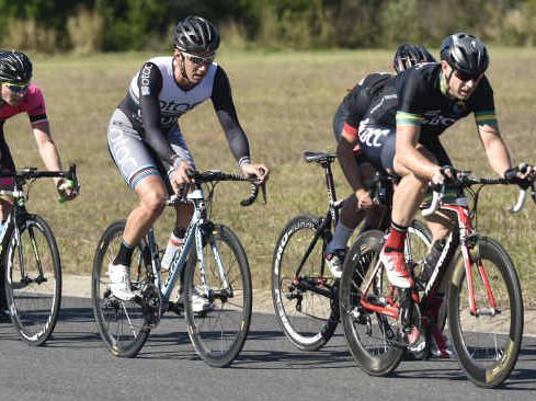 FULL-PELT: Eventual A Grade winner Tim Dalgiesh from Moreton Bay leads the peloton including second place getter Shaun Baxter in the Yamba Shores Tavern Criterium at Yamba Business Park.
